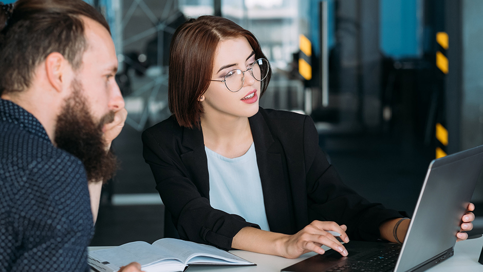 Man and woman consulting over a laptop
